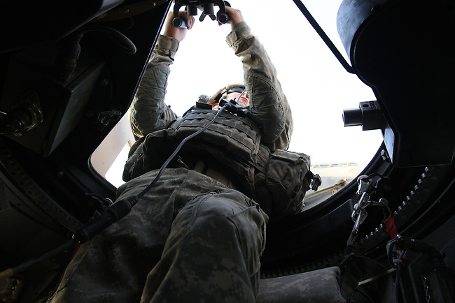 "Spc. David Viscosi, 20, of Holland Patent, N.Y., mans a turret machine gun during a Humvee patrol near the city of Qalat in Zabul province, Afghanistan. Viscosi is a soldier with ""Swamp Fox,"" a mentor team attached to the Afghan police in the district. Aug. 25, 2008. DREW BROWN/STARS AND STRIPES"