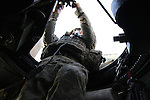 """Spc. David Viscosi, 20, of Holland Patent, N.Y., mans a turret machine gun during a Humvee patrol near the city of Qalat in Zabul province, Afghanistan. Viscosi is a soldier with """"Swamp Fox,"""" a mentor team attached to the Afghan police in the district. Aug. 25, 2008. DREW BROWN/STARS AND STRIPES"""
