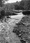 The Little River runs unimpeded through the gap in the dam near Park Road in Oxford during flooding in the spring of 1982.