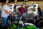 April 21, 2009. Myrtle Beach, SC.. After years of hosting hundreds of thousands of bikers for the annual Bike Week and Black Bike Week rallies, the city council of Myrtle Beach has passed new motorcycle laws to try and put an end to the rallies and promote a more family oriented experience. Many local business owners are outraged at the loss off revenue and the ordinances are to be challenged in court.. James Shore, left, the asst. manager of Scooter and Cycles in downtown Myrtle Beach, shows bikes to Kevin Ault, a laid off construction worker, who now works 2 part time jobs to make ends meet. Shore says he is lucky to sell a bike a week in this economy and worries the new rules will only hurt the shop more.