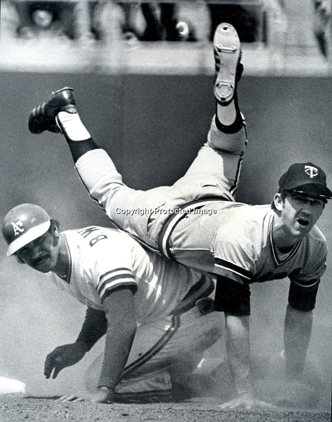 A's Billy Williams upends Twins Danny Thompson to break up double play. (1975 photo copyright Ron Riesterer)