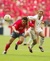 USA's Eddie Lewis fights for the ball. The USA tied South Korea, 1-1, during the FIFA World Cup 2002 in Daegu, Korea.