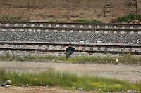 "Lecheria, MEX. 30 July 2014. A inmigrant from Central American  awaits for the train known as ""the beast"" in Lecheria , State of Mexico. Photo by Miguel Angel Pantaleon/VIEWpress"