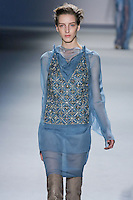 Iris Egbers walks runway in a Dutch blue silk chiffon and organza multi-layer panel dress with cowl neck and crystal mesh bib over silk chiffon boy short, from the Vera Wang Fall 2012 Vis-a-gris collection, during Mercedes-Benz Fashion Week Fall 2012 in New York.