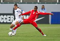 CARSON, CA - March 23, 2012: Johnny Leveron (16) of Honduras and Victor Barrera (9) during the Honduras vs Panama match at the Home Depot Center in Carson, California. Final score Honduras 3, Panama 1.