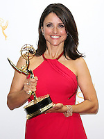 LOS ANGELES, CA, USA - AUGUST 25:  Actress Julia Louis-Dreyfus, winner of the Outstanding Lead Actress in a Comedy Series Award for 'Veep' (Episode: 'Crate'), poses in the press room at the 66th Annual Primetime Emmy Awards held at Nokia Theatre L.A. Live on August 25, 2014 in Los Angeles, California, United States. (Photo by Celebrity Monitor)