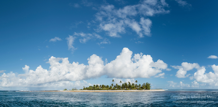 Toau Atoll, Tuamotu Archipelago, French Polynesia; a panoramic view of the palm tree covered island at the edge of Fakatahuna Pass on Toau Atoll