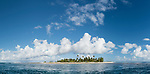 Toau Atoll, Tuamotu Archipelago, French Polynesia; a panoramic view of the palm tree covered island at the edge of Fakatahuna Pass on Toau Atoll