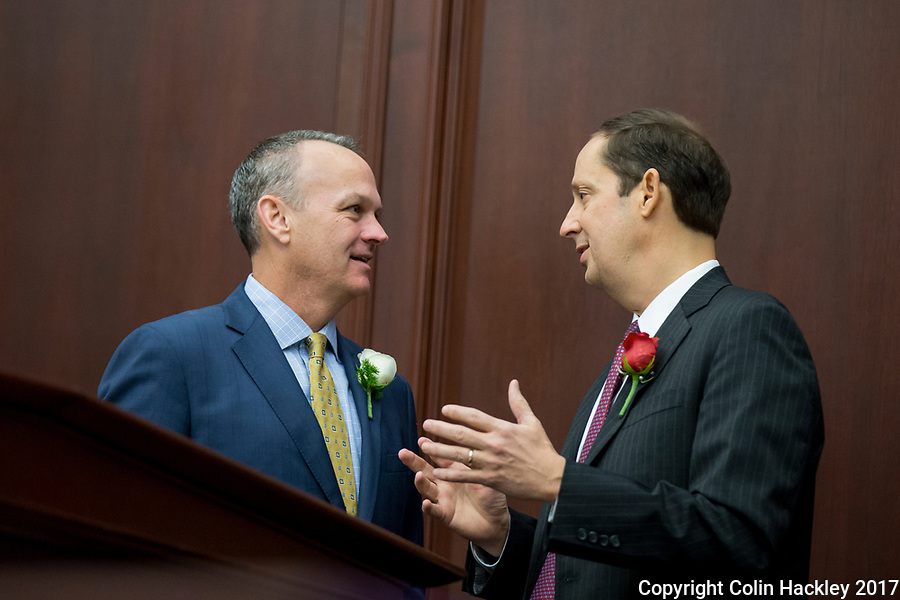 TALLAHASSEE, FLA. 3/7/17-House Speaker Richard Corcoran, R-Land O'Lakes, left, talks with Senate President Joe Negron, R-Stuart, during opening day of the 2017 legislative session at the Capitol in Tallahassee.<br /> <br /> COLIN HACKLEY PHOTO