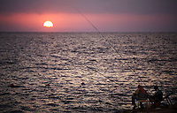 Beirut , Lebanon 20081026 - Two men are fishing as the sun sets by the seaside and the Corniche in Beirut. Photo/copyright: Torbjorn Gronning