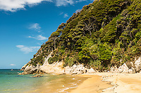 Crystal clear waters and golden sand of Anatakapau Bay on Abel Tasman Coast Track, Abel Tasman National Park, Nelson Region, South Island, New Zealand