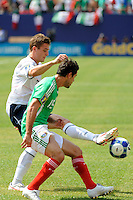 Robbie Rogers (7) of the United States (USA) and Jose Antonio Castro (15) of Mexico (MEX). Mexico (MEX) defeated the United States (USA) 5-0 during the finals of the CONCACAF Gold Cup at Giants Stadium in East Rutherford, NJ, on July 26, 2009.
