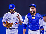 4 April 2015: Toronto Blue Jays pitcher Daniel Norris (left) and catcher Russell Martin walk back to the dugout after their pre-game warm-ups prior to an exhibition game against the Cincinnati Reds at Olympic Stadium in Montreal, Quebec, Canada. The Blue Jays defeated the Reds 9-1 in the second of two MLB weekend exhibition games. The series marked the first time since 2004 that the Reds played at Olympic Stadium, during the last season of the Montreal Expos. Mandatory Credit: Ed Wolfstein Photo *** RAW (NEF) Image File Available ***