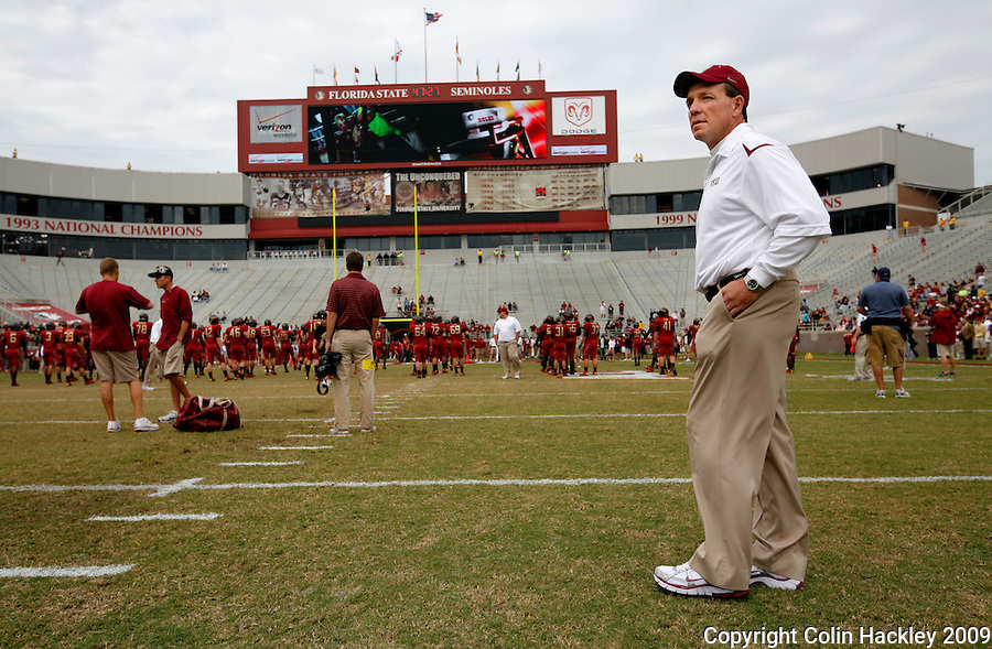 TALLAHASSEE, FL 11/21/09-FSU-MARY FB09 CH04-Florida StateOffensive Coordinator Jimbo Fisher monitors warm up prior to the Maryland game, Saturday at Doak Campbell Stadium in Tallahassee. .COLIN HACKLEY PHOTO