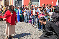 Jesus Drives the Unclean Spirit out of the Afflicted Man.  (Luke 4:33-37).  Palm Sunday Re-enactment of events in the life of Jesus, by the group called Luna LLena (Full Moon), a group of volunteers in Antigua, Guatemala.