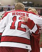 Colin Moore (Harvard - 12), Lisa Moore - The Harvard University Crimson defeated the visiting Clarkson University Golden Knights 3-2 on Harvard's senior night on Saturday, February 25, 2012, at Bright Hockey Center in Cambridge, Massachusetts.