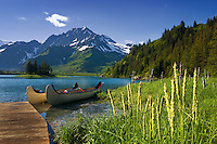 Two canoes await their passengers at the stunning Kenai Fjords Glacier Lodge on Lower Pedersen Lagoon in Aialik Bay,  Kenai Fjord National Park.
