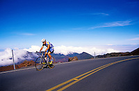 A biker arrives at the summit of Haleakala (a 10,023-ft. elevation) in Haleakala National Park on Maui. This is the finish line for the annual 38-mile Cycle to the Sun bike race.