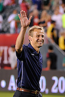 United States head coach Jurgen Klinsmann salutes the fans after the match. The men's national teams of the United States (USA) and Mexico (MEX) played to a 1-1 tie during an international friendly at Lincoln Financial Field in Philadelphia, PA, on August 10, 2011.