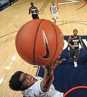 CHARLOTTESVILLE, VA- DECEMBER 6: Jontel Evans #1 of the Virginia Cavaliers shoots a basket in front of Corey Edwards #13 of the George Mason Patriots during the game on December 6, 2011 at the John Paul Jones Arena in Charlottesville, Virginia. Virginia defeated George Mason 68-48. (Photo by Andrew Shurtleff/Getty Images) *** Local Caption *** Jontel Evans;Corey Edwards