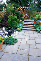 Bluestone paver patio with inlaid chess set, plantings, hot tub, steps, levels, arbor, patio set 37713