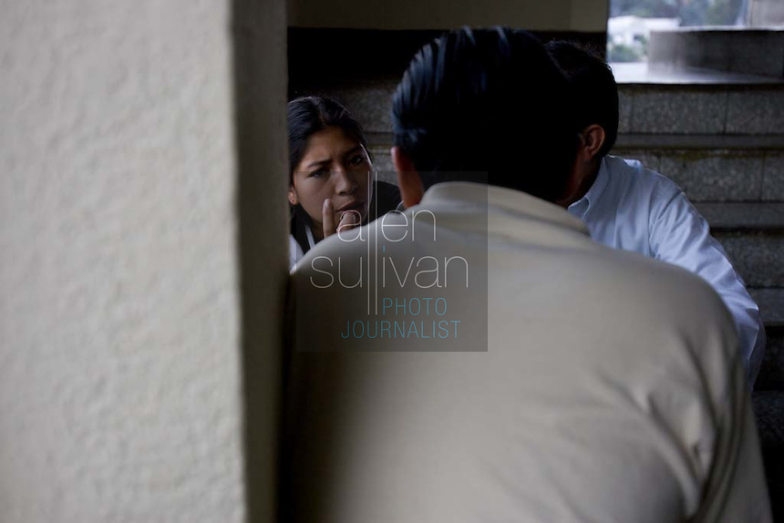 Wilma Janet Chacon (left), a 17-year-old girl who at times is a niña de la calle, speaks with Carlos Toledo and Alejandro Estrado of Nuestros Derechos--Our Rights- a Guatemalan non-governmental organization that tries to help the children off the streets and into society, in the children's court of the Organismo Judicial in Guatemala City. Toledo and Estrada were helping Chacon try to get joint custody of the child she had with another street child who has since reformed himself. The court said she had to stay off the streets in order to have any custody. Not long after, she chose the streets.