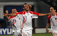 Costa Rica's Marcos Urena (7) celebrates the winning goal against Egypt with teammates, Jorge Castro (9), left, and  Diego Madrigal (11), right, during the FIFA Under 20 World Cup Round of 16 match between Egypt and Costa Rica at the Cairo International Stadium on October 06, 2009 in Cairo, Egypt.