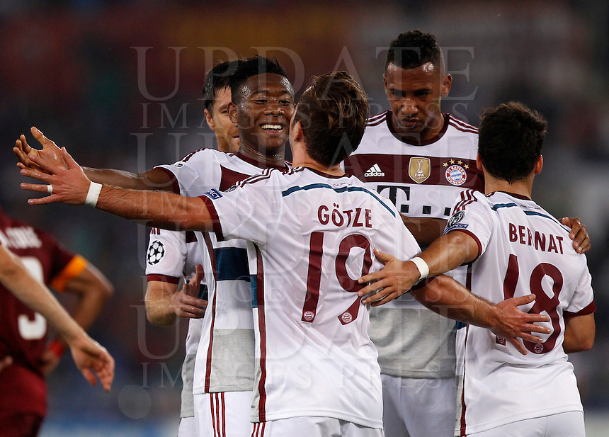 Calcio, Champions League, Gruppo E: Roma vs Bayern Monaco. Roma, stadio Olimpico, 21 ottobre 2014.<br /> Bayern&rsquo;s Mario Goetze, center, n.19, back to camera, celebrates with teammates after scoring during the Group E Champions League football match between AS Roma and Bayern at Rome's Olympic stadium, 21 October 2014.<br /> UPDATE IMAGES PRESS/Isabella Bonotto