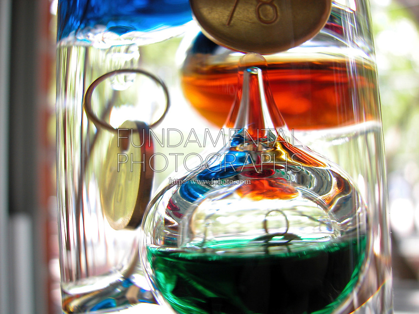 GALILEO THERMOMETER OR TERMOMETRO LENTOS <br /> (Variations Available)<br /> Principle of Galileo's Thermoscope<br /> Specifically weighted floating bubbles predictably rise or sink in a liquid as the temperature of that liquid changes. The refraction of light by the liquid in the column causes the bubbles to appear different in size.