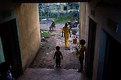 A family seen outside their flats in Belgharia township outside of Dhanbad in Jharkhand, India. Families from various villages with underground fires have been rehabilitated in Belgharia township. Photo: Sanjit Das/Panos