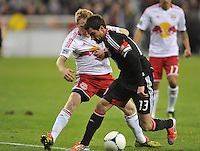 D.C. United midfielder Chris Pontius (13) goes against New York Red Bulls midfielder Dax McCarty.  The New York Red Bulls tied D.C. United 1-1 in the first leg of the Eastern Conference semifinals at RFK Stadium, Saturday November 3, 2012.