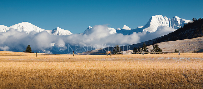 Snow covered peaks of the Mission Mountains and low clouds in western Montana winter