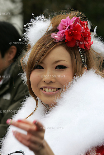 TOKYO - JANUARY 11: A woman in kimono smiles at a photographer during the annual Coming-of-Age Day ceremony on January 11, 2010 at Tokyo Disneyland in Urayasu city, Chiba prefecture , Japan. (Photo by Laurent Benchana/Nippon News)