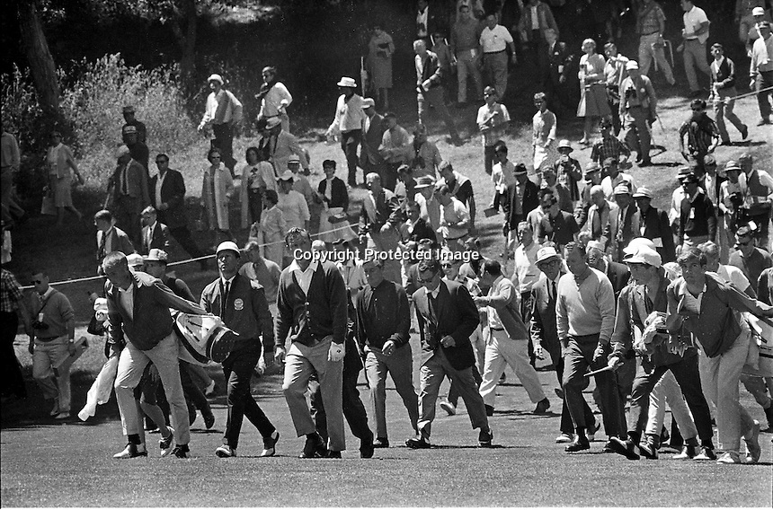 Arnold Palmer and Billy Casper walk up the 18th hole at the Olympic Club in San Francisco during the 1966 U.S. Open wonby Casper in play-off. (Photo by Ron Riesterer)