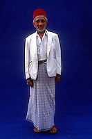 A Moor gentleman traditionally dressed. A common sight in Sri Lanka till the late 1960's. This gentleman was photographed in Galle against a blue canvas portable background..
