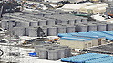 February 26, 2012, Fukushima, Japan - Water tanks installed on the premises of the Fukushima No. 1 Nuclear Power Plant are pictured in this aerial photo taken from a Mainichi helicopter on Feb. 26, 2012.