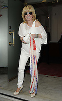 Lulu Kennedy-Cairns.The Prince Albert II of Monaco Olympians Reception, Old Burberry Building, Haymarket, London, England..August 9th, 2012.full length white trousers off the shoulder top purse bag union jack flag wrap sunglasses shades .CAP/CAN.©Can Nguyen/Capital Pictures.