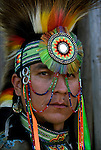 Portrait of  Keith Sharphead, Plains Cree, Thunderbird Pow-Wow in Queens County Farm, New York.<br /> <br /> His regalia is an example of ethnic pride, heritage and a celebration and traditional Native American folk art crafts.