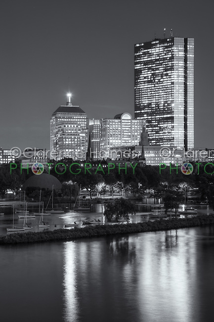 Twilight view of the Boston skyline including the John Hancock building, as seen over the Charles River from the Longfellow Bridge.