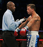WBC Junior Welterweight Champion Arturo Gatti argues a knockdown with referee Earl Morton during his 12 round bout against Floyd Mayweather at Boardwalk Hall in Atlantic City, NJ.  Floyd Mayweather won the fight via 7th round stoppage.