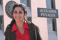 """File photo of Mexican journalist Lydia Cacho after being released from prison, December 16, 2005. Cacho was arrested in the southern resort city of Cancun and drove her in a 24-hours trip to face demafamation charges in the eastern Puebla city. She is free on bail.. Cachor wrote a book """"The Demons of Eden"""" denouncing networks of paedophiles and child pornographers.  © Photo by Javier Rodriguez.."""