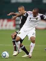 Real Salt Lake midfielder Collen Warner (26) shields the ball against DC United defender Jordan Graye (16)   DC United and Real Salt Lake tied 0-0 at RFK Stadium, Wednesday  June 2  2010.