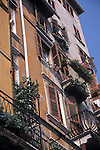 Shutters, Balconies and Flower Boxes on Building in Verona, Italy, Europe