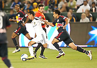 CARSON, CA – May 7, 2011: LA Galaxy midfielder Juninho (19) tries to elude a New York defender during the match between LA Galaxy and New York Red Bull at the Home Depot Center, May 7, 2011 in Carson, California. Final score LA Galaxy 1, New York Red Bull 1.