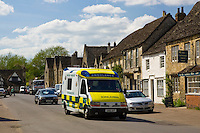 Emergency vehicle drives through Lacock, Wiltshire, United Kingdom