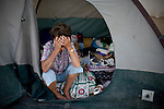 RENO, NV - OCTOBER 6:  Barbara Lehman sits in the tent she calls home in a tent city for the homeless in downtown Reno, Nevada October 6, 2008. Lehman lost her job in July after a broken arm left her unable to work. The City of Reno set up the tent city when existing shelters became overcrowded as Nevada struggles with one of the highest unemployment rates in the country.