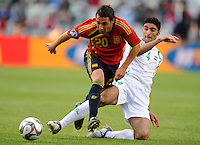 Santi Cazorla (20) of Spain and Fareed Majeed (4) of Iraq. Spain defeated Iraq 1-0 during the FIFA Confederations Cup at Free State Stadium, in Mangaung/Bloemfontein South Africa on June 17, 2009.