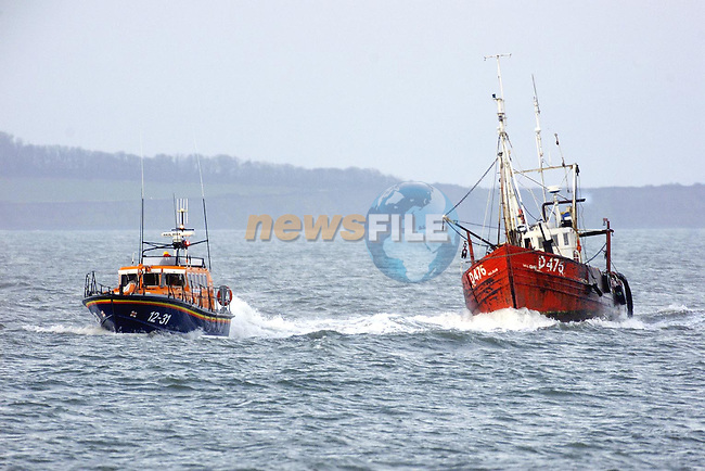 Clogherhead lifeboat towing a boat back to land on Monday afternoon after it started taking in water..Picture: Paul Mohan/Newsfile