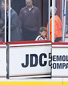 John Hegarty (BC - Director-HockeyOps) watches Matt Conway's son close the door to the ice. - The Boston College Eagles defeated the visiting Colorado College Tigers 4-1 on Friday, October 21, 2016, at Kelley Rink in Conte Forum in Chestnut Hill, Massachusetts.The Boston College Eagles defeated the visiting Colorado College Tiger 4-1 on Friday, October 21, 2016, at Kelley Rink in Conte Forum in Chestnut Hill, Massachusett.