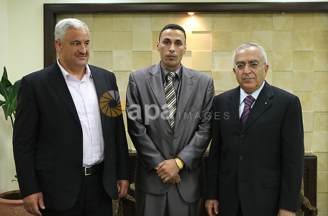 Palestinian Prime Minister Salam Fayyad, during a meeting with Sergeant Ibrahim Youssef al-Hajj Mustafa with General Ziad Hab Reeh ,in West Bank city of Ramallah on August 25,2010.  Photo by Mustafa Abu Dayeh \ pool